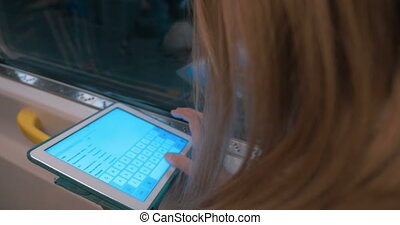 Woman Working With Digital Tablet Pc - Close-up of woman...