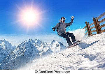 Snowboarder freerider - Snowboarder man holding snowboard in...