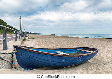 Bournemouth Beach - A rowing boat on the beach at...