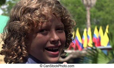 Boy Posing with Colombian Flags