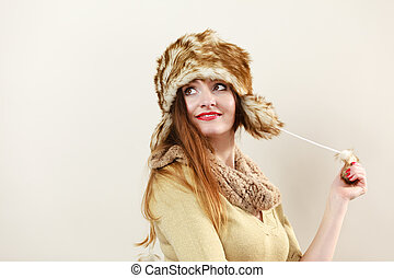 woman wearing wintertime clothes fur cap - Winter fashion...