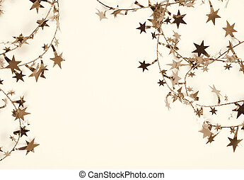 Golden stars and spangles as holiday background. In Sepia...