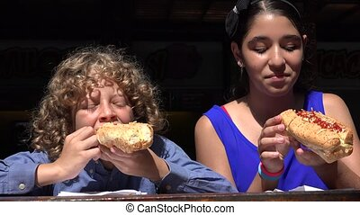 Siblings Eating Hot Dog Lunch