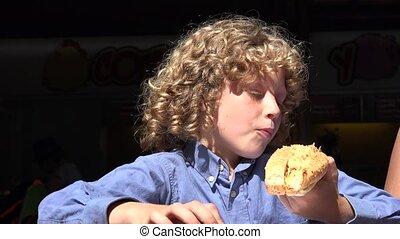 Boy Eating Hot Dog Lunch