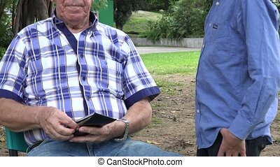 Grandfather Giving Money to Grand Kids