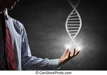 Dna molecule concept - Hand of businessman holding dna...