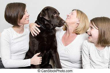 Three Generations of a Family with their Dog - Shot of Three...