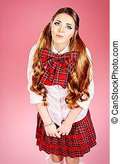 eyeliner - Cute smiling teen girl in school plaid skirt and...
