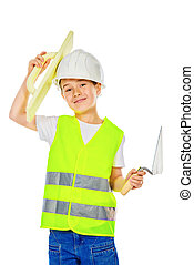 game in profession - A boy in a costume of a builder posing...