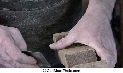 carpenter working in his workshop - smoothing cuts at the...