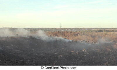 Large garbage dump waste with smoke - Large garbage dump...