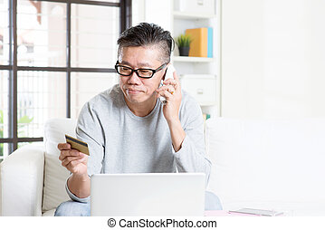 Making order by phone - Asian mature man making order by...