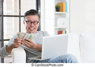 Making money from online business - Portrait of happy 50s...