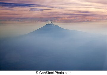 Popocatepetl volcano Mexico DF city aerial view -...