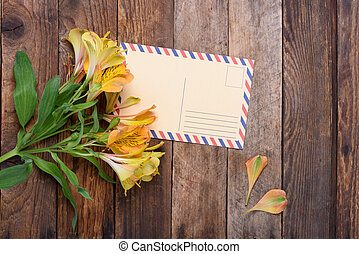 Retro postcard with flowers on vintage wooden table still...