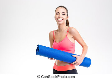 Portrait og smiling happy charming fitness girl with yoga...