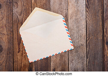 Open vintage envelope on old wooden table still life