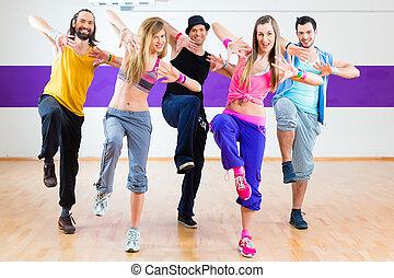 Dancer at Zumba fitness training in dance studio - Group of...