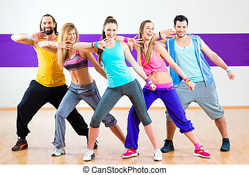 Dancer at Zumba fitness training in dance studio - Group of...