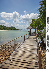 Beach hut - Image of a wooden jetty leading to a beach hut....