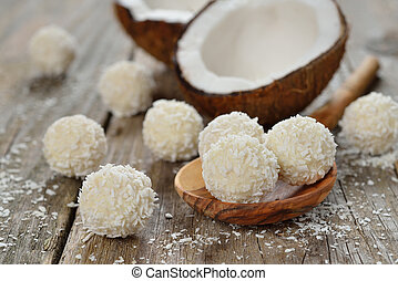 Coconut praline on a wooden background