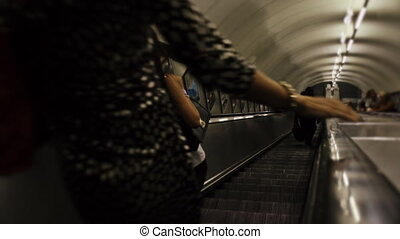 Commuters on the escalator downward