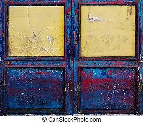 Detail of old grunge door - Old grungy wooden door with...