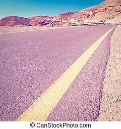 Road - Winding Asphalt Road in the Negev Desert in Israel,...