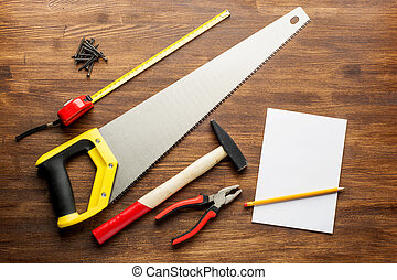 joinery tools on wood table background with note book and...