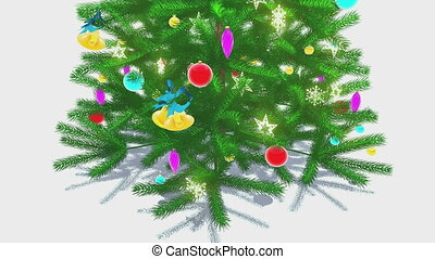 Rotating decorated christmas tree - Close-up of the rotating...