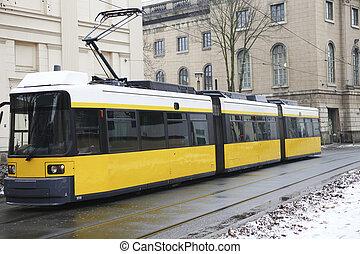 Tram in Berlin - Yellow electric tram in Berlin in winter