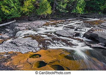 Manido Falls - The Presque Isle River flows over the rock...