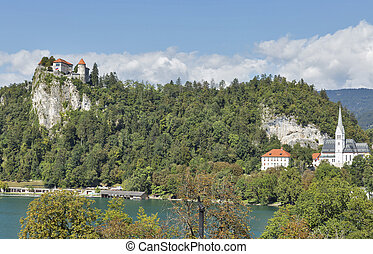 Medieval castle, St. Martins Church and Bled Lake at autumn