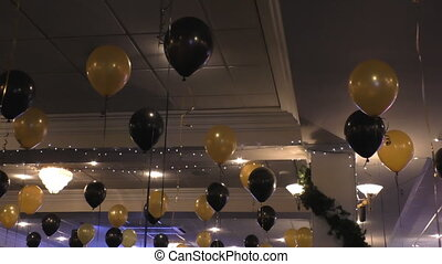 Party decorations - Helium filled balloons floating on the...
