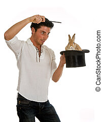 Big moment of success - Young man showing a rabbit in a top...