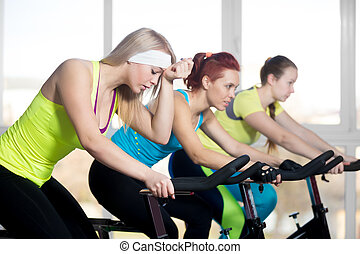Group of cyclist women in sports club - Fitness practice,...