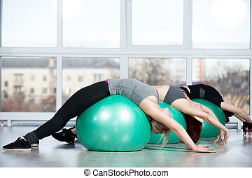 Backbend exercises on balls - Fitness practice, group of...