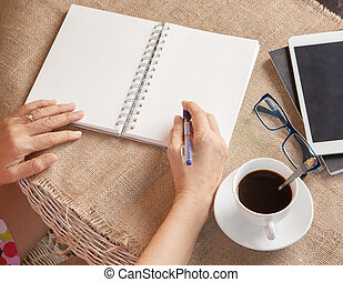 woman writing shot memories note on white paper with...
