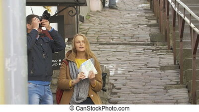 Couple of tourist with camera and map