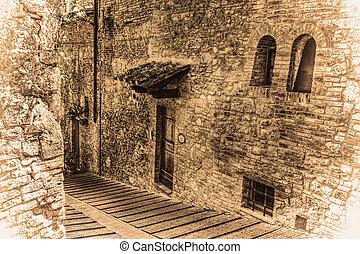 narrow backstreet in San Gimignano in vintage tone, Italy