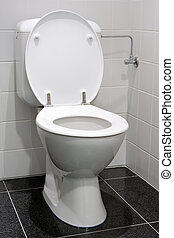White toilet - Clean and white toilet in a bathroom
