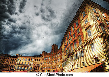 historic buildings in Piazza del Campo in Siena, Italy