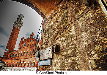 Piazza del Campo in Siena seen from an arch, Italy