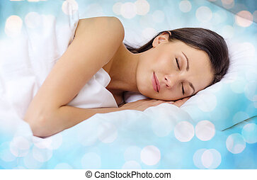 beautiful woman sleeping in bed - rest and comfort concept -...