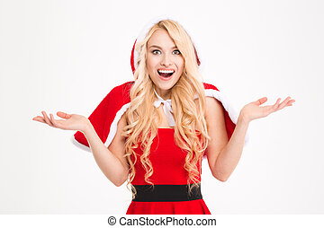 Woman in santa claus costume holding copyspace on both palms...