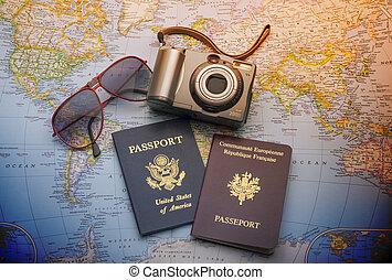 Passports to world travel - Passports, camera and sunglasses...