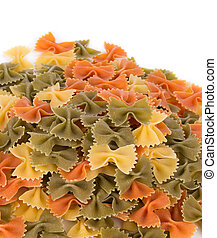 Bunch of the farfalle pasta three colors Whole background