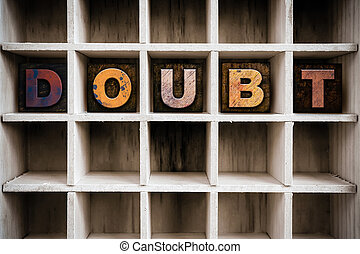 Doubt Concept Wooden Letterpress Type in Draw - The word...