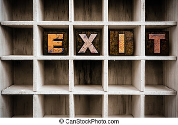 Exit Concept Wooden Letterpress Type in Draw - The word EXIT...