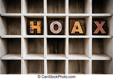 Hoax Concept Wooden Letterpress Type in Draw - The word HOAX...